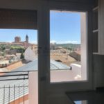 Lloguer pis reformat amb ascensor i parquet a Gironella, Berguedà: 3 habitacions, molt lluminós-Buscallà Immobiliària: cuina vistes-lp161